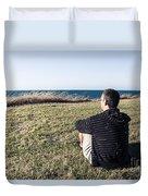 Caucasian Traveler Relaxing On Grass Outdoors Duvet Cover