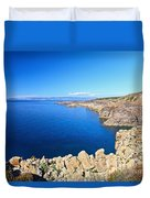 cliff in San Pietro Island Duvet Cover