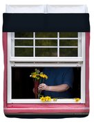 Mature Woman Cutting Flowers In Window Duvet Cover