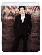 Vintage Salesman Standing In Front Of Brick Wall Duvet Cover