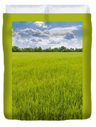 A Field Of Green Wheat Under A Cloudy Sky Duvet Cover