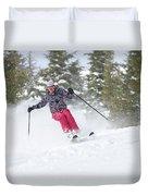 A Skier Descends A Snowy Slope Duvet Cover