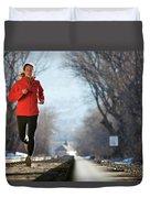 A Woman Running Near A Railroad Track Duvet Cover