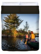 A Young Couple Paddles A Canoe On Long Duvet Cover