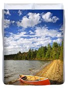 Red Canoe On Lake Shore Duvet Cover by Elena Elisseeva