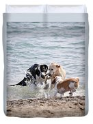 Three Dogs Playing On Beach Duvet Cover