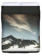 A Backpacker Gazes Up At Needle Peak Duvet Cover