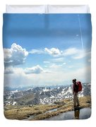 A Backpacker Stands Atop A Mountain Duvet Cover