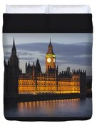 A Building And Clock Tower Along The Duvet Cover by Charles Bowman