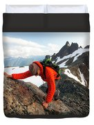 A Climber Scrambles Up A Rocky Mountain Duvet Cover