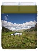 A Couple Hiking Through A Field Duvet Cover