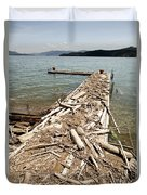 A Dock Covered With Driftwood Duvet Cover