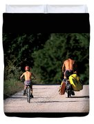 A Father And Son Ride Their Bikes To Go Duvet Cover