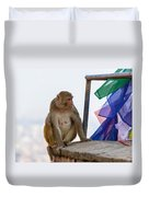 A Female Macaque On Top Of Wall Duvet Cover