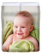 A Happy Baby Lying On Bed In Green Towel Duvet Cover
