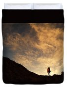 A Hiker Standing On A Ridge At Sun Rise Duvet Cover