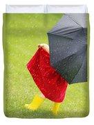A Little Girl Walking In The Rain While Duvet Cover