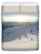 A Lone Skier Makes A Turn At Whitefish Duvet Cover