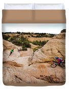 A Male And Female Mountain Biker Ride Duvet Cover