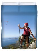 A Male Climber Looking At Paragliding Duvet Cover
