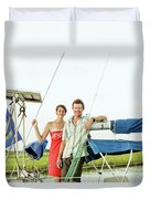 A Man And A Woman Embrace In Sailboat Duvet Cover