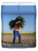 A Man Harvests Sedge To Be Used Duvet Cover