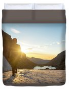 A Man Hiking On Snowfield At Sunrise Duvet Cover