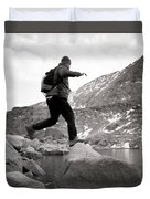 A Man Jumps From One Rock To Another Duvet Cover