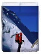 A Man Mountaineering In The Alps Duvet Cover