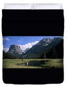 A Man Pulls His Canoe Up A River Valley Duvet Cover