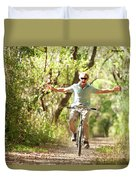 A Man Rides A Bicycle Duvet Cover