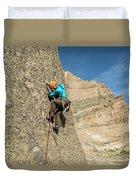 A Man Rock Climbing In Rocky Mountain Duvet Cover