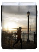 A Man Running On A Dock In The Harbour Duvet Cover