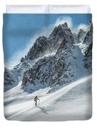 A Man Ski Touring In The Mountains Duvet Cover