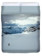 A Man Ski Touring Near Icefall Lodge Duvet Cover