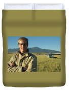 A Man Stands In A Field Next Duvet Cover