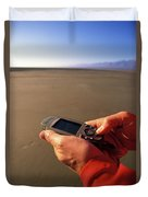 A Man Using A Gps Device At Sunset Duvet Cover