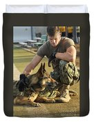 A Military Working Dog Handler Pets Photograph By