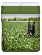 A Military Working Dog Sits In A Field Duvet Cover by Stocktrek Images