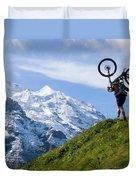 A Mountain Biker Is Carrying His Bike Duvet Cover