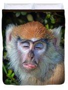 A Patas Baby Monkey Behaving Badly Duvet Cover