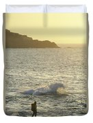 A Person Hiking On Rocky Shore Duvet Cover