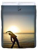 A Person Practices Yoga At The Waters Duvet Cover
