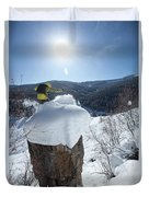 A Snowboarder Jumps Off A Cliff Duvet Cover