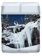 A Snowboarder Jumps Off An Ice Duvet Cover