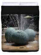A Water Fountain With Dinosaur Eggs In The Universal Studios Singapore Duvet Cover
