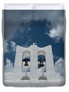 A Whitewashed Bell Tower And Dramatic Duvet Cover