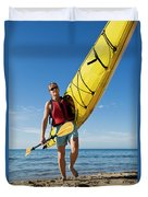 A Woman Carrying Her Sea Kayak Duvet Cover