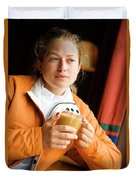 A Woman Enjoys A Warm Cup Of Cocoa Duvet Cover