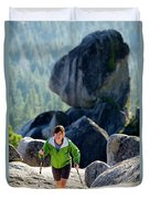 A Woman Hiking High In The Mountains Duvet Cover